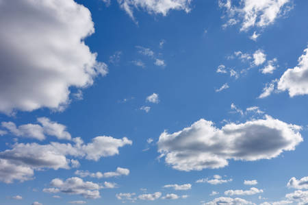 White fluffy clouds in the blue sky. Blue summer sky with white cumulus clouds. 版權商用圖片