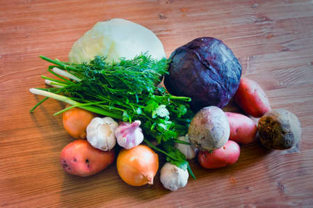 Set of various vegetables cabbage potatoes carrots onion garlic parsley dill beet ginger on a wooden table background