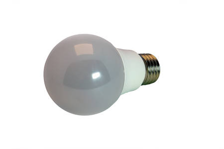 Dot diode lamp for a spotlight in an arch or a false ceiling, white background, close-up, isolate.