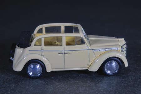 Children's toy car white on a dark background. 免版税图像