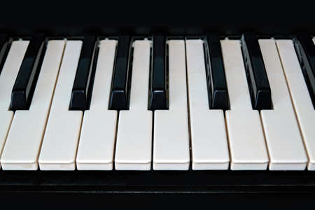 Close up photo of keyboard of piano or electronic digital midi synthesizer.