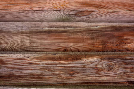 The texture of the boards of an old wooden fence closeup. Close up of gray wooden fence panels. 免版税图像