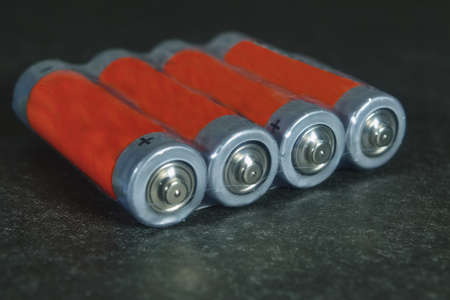 Packing electric alkaline batteries on a dark background.