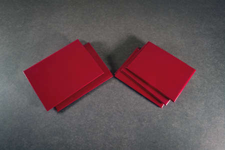 Two piles of covers on a dark background close-up.
