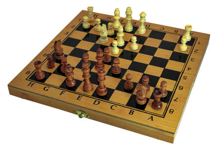 Chess pieces stand on a wooden board close-up isolated on a white background. Imagens