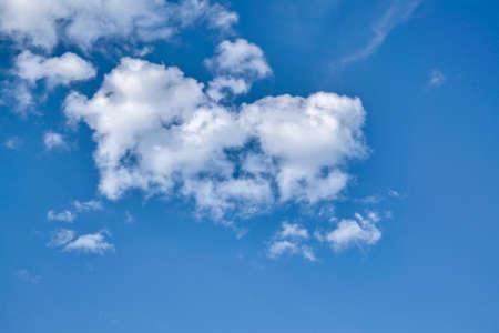 Blue sky with cumulus clouds. Cumulus clouds in the blue sky. Beautiful clouds in the blue sky background.