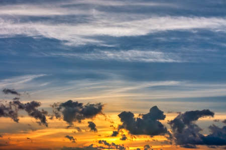 Evening sky in the picturesque clouds, lit by the rays of the setting sun. Stockfoto