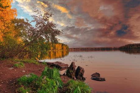Picturesque autumn landscape by the lake. Autumn landscape by the lake at sunset.