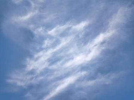 White fluffy clouds in the blue sky. Blue summer sky with white cumulus clouds. Stock fotó