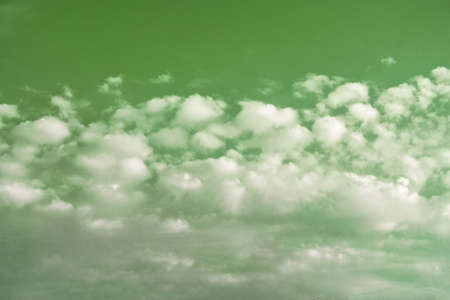 Beautiful fantastic green sky background with white clouds. Stock fotó