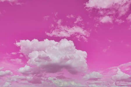 Beautiful pink sky background with white clouds.