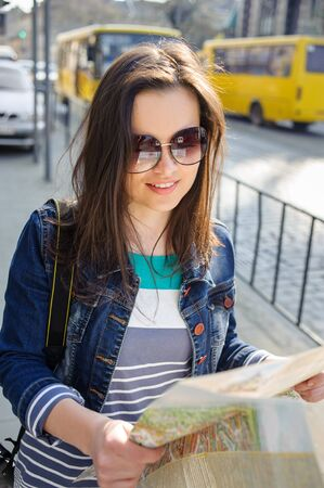 portrait of a young woman with map in Lviv old city center in Ukraine Stock Photo