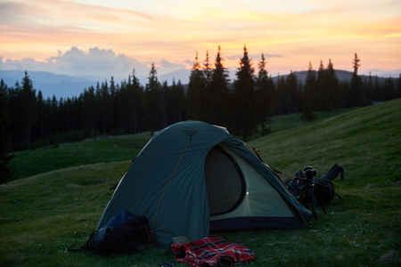 Shot of a tourist tent placed on top of a hill beautiful sunset on the background active sportive lifestyle travelling freedom peace blissful nature