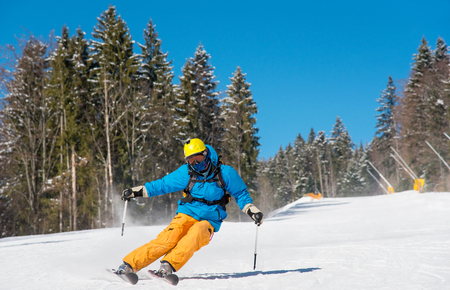 Professional skier riding down at the winter resort in the Carpathians mountains copyspace extreme travelling recreation resort people adventure living concept Stock Photo