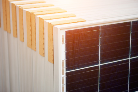 Close-up of new solar photo voltaic modules set ready for buying, transportation and installation. Renewable eco-friendly green energy production and panel system installation concept. Banco de Imagens