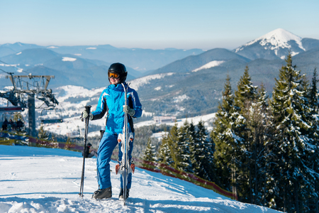 Full length shot of a female skier in winter sportswear posing on top of a mountain with her skis copyspace active seasonal sport lifestyle recreation resort concept.
