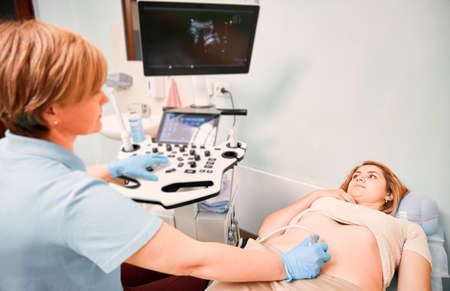 Female patient undergoing ultrasound procedure in medical center.