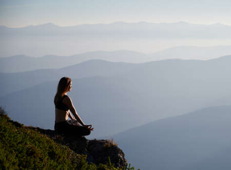 Side view of young woman enjoying nature and beautiful landscape. Concept of meditation. Stok Fotoğraf
