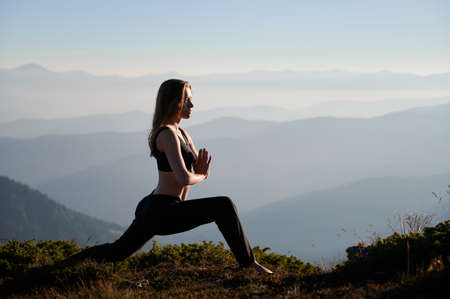 Side view of sporty young woman doing workout on fresh air. Concept of incredible nature. Stok Fotoğraf