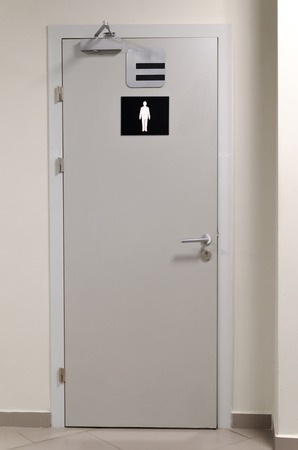 piss: grey toilet doors for male genders in the airport Stock Photo