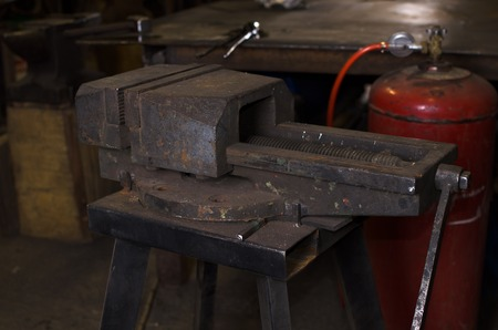 vice grip: jaw vice in workshop. handcraft instrument in forge. Stock Photo