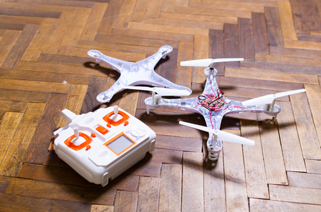 hit tech: Broken drone on the floor in flat.