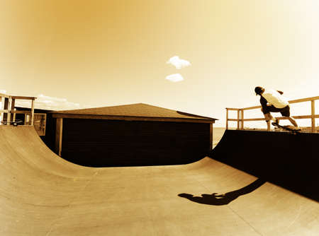 raider: Skateboard raider in rampa start trick. Orange filter concept. Blank space in sky place