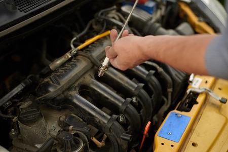 spark plug: Fixing new spark plug in old car.