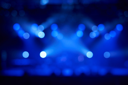 Blurred concert blue lights on stage. Night music live concept. Advertising of perfomance. Stock Photo