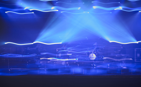 concert lights: Blurred concept of night life. Crowd in front of stage with blue concert lights.