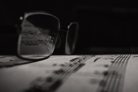 The glasses on sheet music Stock Photo