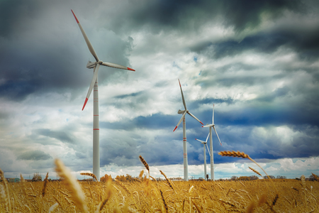 Wind Generator Turbines over Blue Sky - Green Renewable Energy