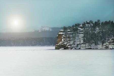 january sunrise: A small rocky island in the frozen winter Baikal Lake