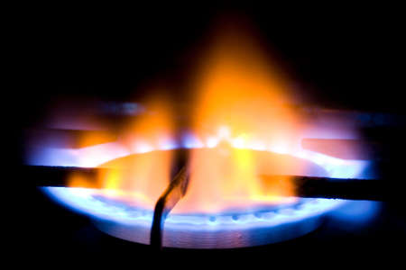 Natural gas burner with flame isolated on black background photo