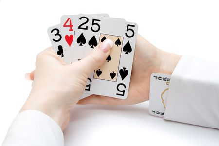 woman hands holding playing cards with poker straight combination and a joker up the sleeve Stock Photo - 2848267