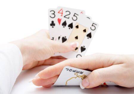 woman hands holding playing cards with poker straight combination and a joker being drawn Stock Photo - 2848265