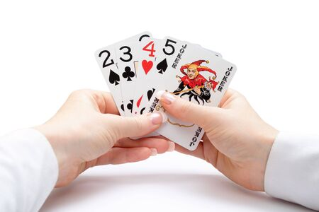 woman hands holding playing cards with poker straight combination and a joker Stock Photo - 2848266