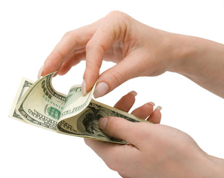 US Dollars in womans hand, over white, isolated with clipping path photo