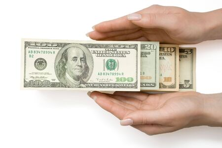 US Dollars in ladder in womans hand, over white, isolated with clipping path photo