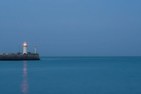 rote: Lighthouse in twilight Stock Photo