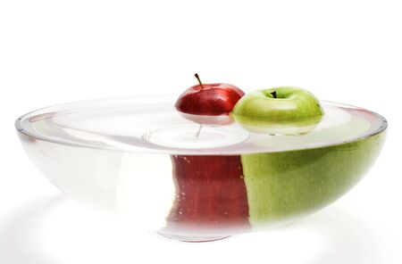 Green and red apples in vase with water - 3, isolated photo