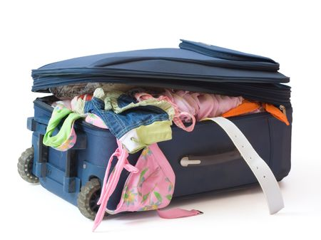 Suitcase full with summer clothes ready for the summer holidays photo