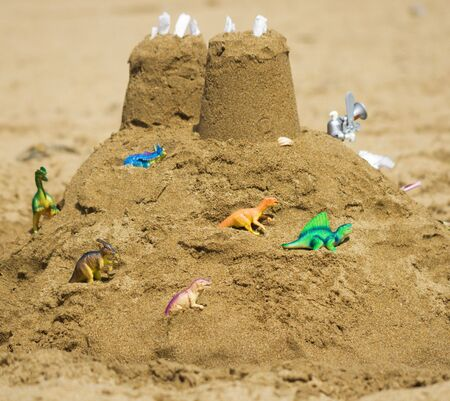 attacked: Sand fortress attacked by dinosaurs