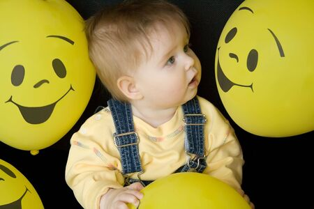 baby girl looking at face on balloons, amazed Stock Photo - 3283778