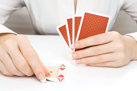 Woman putting the playing card on the table or taking it