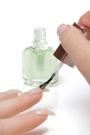 Applying top coat on nails,isolated Stock Photo