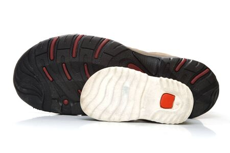 outsole: Big male and small  sneaker shoes – outsole view, isolated, on white background