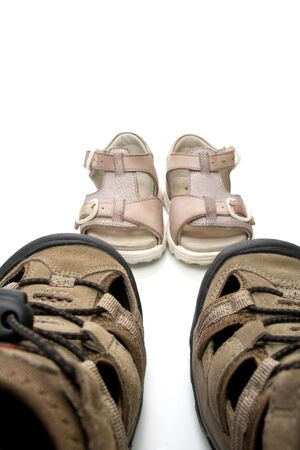 gigantic: Big male and small  walking sandals, isolated, on white background