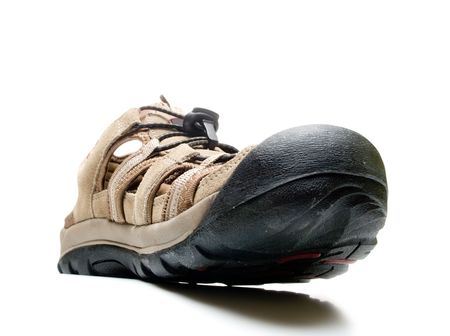 outsole: Male shoe with huge toe, shot from the bottom point, isolated, over white