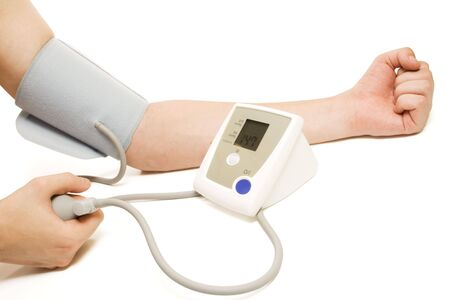 Man monitoring blood pressure with tonometer, isolated, with clipping path, on white background photo